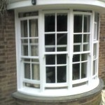 Exterior glosswork on classical bay windows