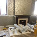 Bespoke wall coverings in progress, paper hanging and artworks