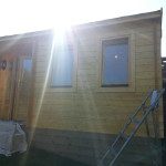 Summer house painted, compliments the garden