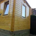 Summer house painted in light stain work