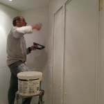 Terry Fearn tiling a bathroom at a five star hotel