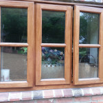 Exterior decorating, professionally stained and glossed windows